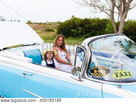 Varadero, Cuba - May 20, 2021: Oldsmobile Super 88 1959 In Cuba. People In A Convertible