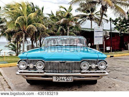 Varadero, Cuba - May 20, 2021: Oldsmobile Super 88 1959 In Cuba. Driver Driving A Convertible