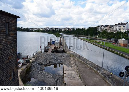 Koblenz, Germany - August 10th 2021: River Lock Of The Mosel With The Canal Separsted From The River