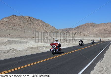 Inyo County, Usa - April 13, 2014: Motorcyclists Ride In Death Valley, California. Death Valley Nati
