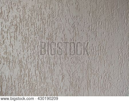 Decorative Embossed Concrete And Glue Plaster. Gray Plastered Wall. Background Of Gray Old Concrete