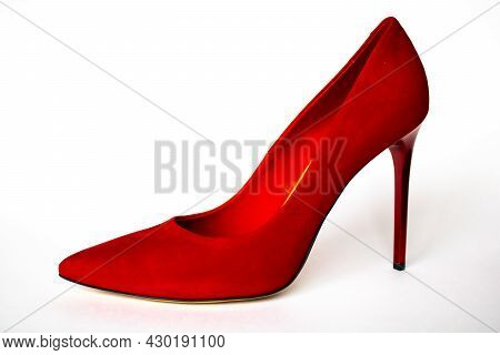 Red Elegant Classic Stiletto Heels On A White Background. One Red High-heeled Shoe.