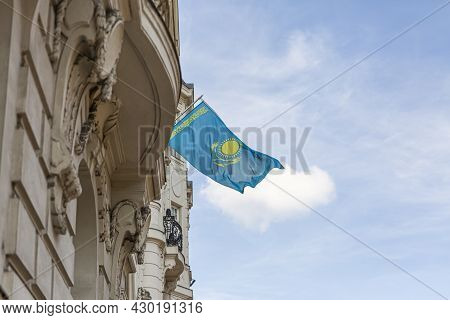 Kazakhstan Flag Agains Blue Sky. Kazakhstan Flag Hanging On A Pole In Front Of The House. National F