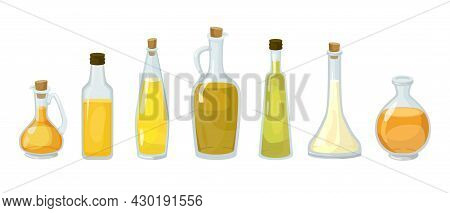 Glass Bottles Of Different Types Of Oils. Cold Pressed Coconut, Cannabis, Canola, Corn, Olive And He
