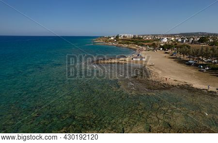Aerial Drone View Of Agia Triada Coast With People Swimming In The Sea. Protaras Paralimni Cyprus