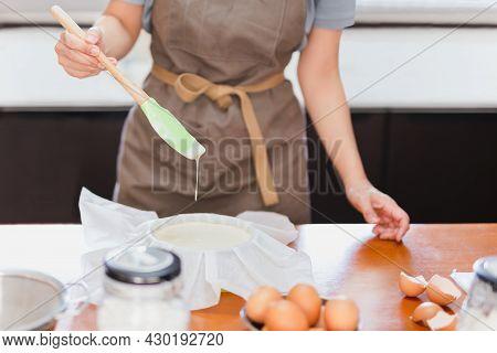 Baker Woman Preparing Cake Mix Dough In Form For Baking Tin