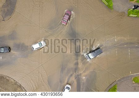Aerial View Of Traffic Cars Driving On Flooded Road With Rain Water.