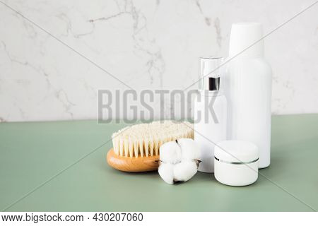 Empty White Cosmetic Containers, Jars And Body Brush Sit On The Bathroom Shelf. A Set Of Cosmetics F