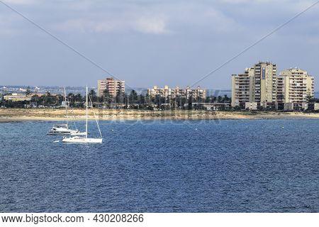 Cabo De Palos, Cartagena, Spain- July 21, 2021: Views Of The Coast Of La Manga From Cabo De Palos Li