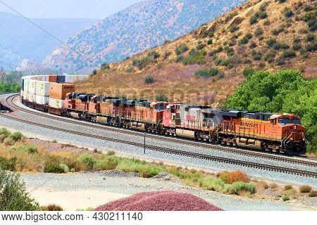 August 17, 2021 In Cajon Pass, Ca:  Four Engines Hauling Many Rail Cars With Merchandise Northbound