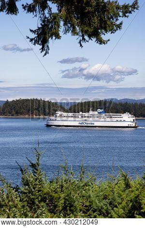 Victoria, Vancouver Island, British Columbia, Canada - August 8, 2021: Bc Ferries Boat Leaving The T