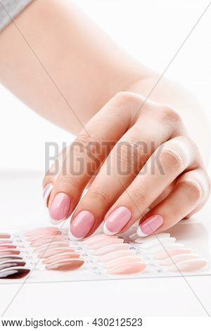 Well-groomed Female Hands With Elegant French Manicure. Beauty Salon. Photo For The Catalog. High Qu