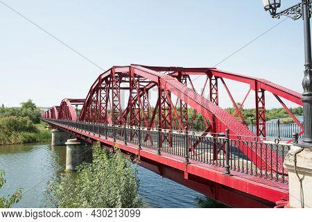 Red Iron Bridge Over Tajo River On A Sunny Day. Talavera De La Reina, Toledo, Spain, Europe