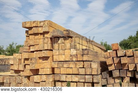 Stack Of Softwood Lumber In A Lumber Shop Outdoors Against Blue Sky