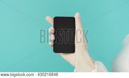 Hand Holding Empty Blank Black Card.hand With Ppe Suit, Latex Glove On Mint Green Or Tiffany Blue Ba
