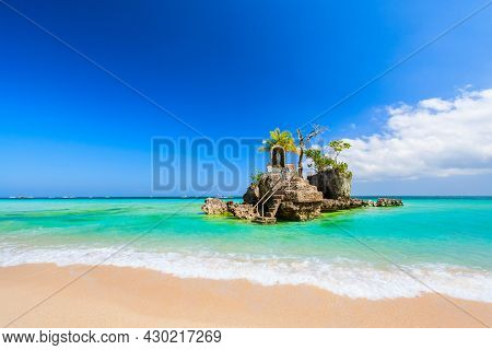 Willys Rock Is A Tidal Island With A Statue Of The Virgin Mary At The Boracay Beach In Philippines