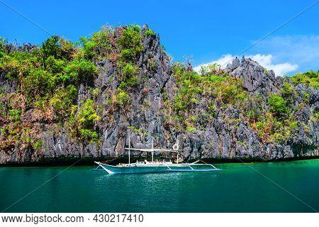 Traditional Filipino Boat Bangka Or Banca At The Blue Lagoon In El Nido Province, Palawan Island In