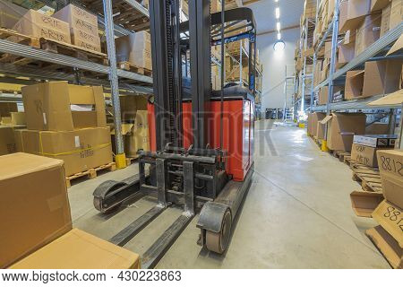 Close Up View Of Storage Warehouse. Fork Lift Truck In Warehouse Store.  Transportation Concept.  08