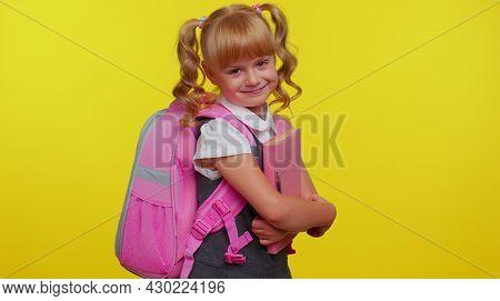 Cheerful Happy Teenage Schoolgirl Kid With Books Dressed In Uniform Wears Pink Backpack Smiling, Loo