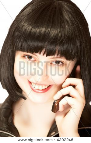 Young Beautiful Brunette Talking To Mobile Phone With Smile