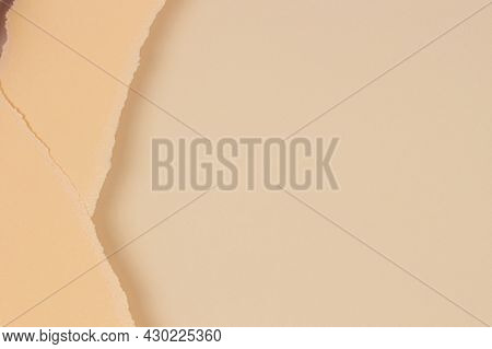 Two Pieces Of Torn Paper On Blank Beige Paper Background. Abstact Monochrome Earthy Color Background