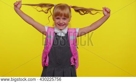 Joyful Girl Kid In School Uniform, Play With Pony Tails Laugh Fooling Around Showing Tongue Making P