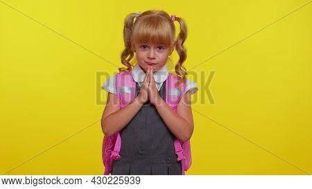 Please, Help. Attractive Blond Teenage Student Girl Kid In School Uniform Praying, Looking Upward An