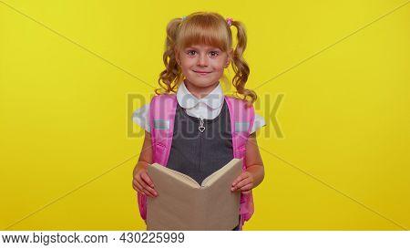 Cheerful Smiling Cute Teenage Schoolgirl Kid With Books Dressed In Uniform Wears Pink Backpack, Look