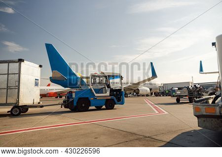 Airfield Tractor Near Big Modern Airplane. Preparation Of Aircraft In Airport Hub On A Daytime