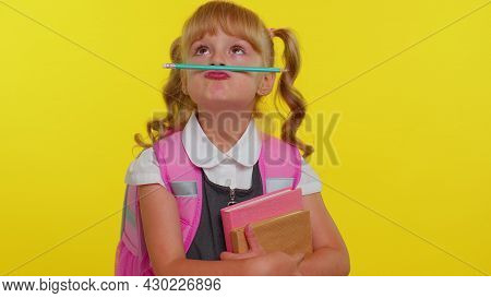 Funny Positive Kid Primary School Girl With Ponytails Wearing Uniform Making Playful Silly Facial Ex