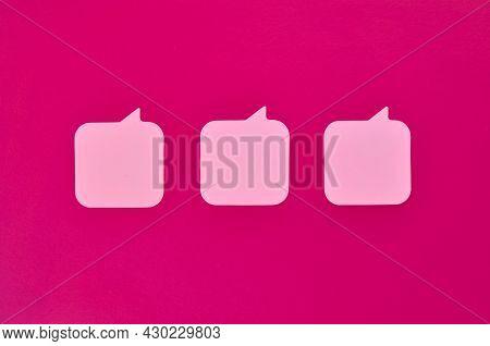 Three Pink Message Stickers On Crimson Background