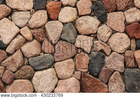 Beautiful Background From Natural Stones Of Different Colors. Decorative Masonry Of The Wall From La