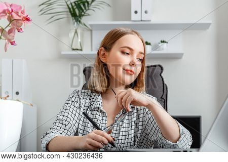 Young Woman Freelance Graphic Designer Working Using Graphic Tablet And Laptop In Home Office Interi