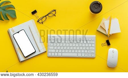 Office Table Desk With Computer Keyboard Glasses, Smartphone Mouse Office Supplies Plants Coffee Cup