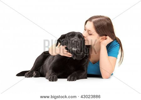 Young female hugging and kissing her dog poster