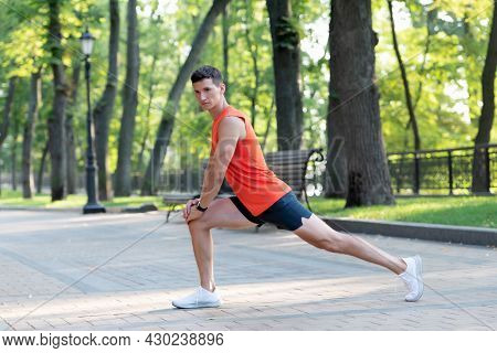 Warming Up Before Workout. Fit Guy Hold Lunge Position. Man Do Warm-up Exercises. Warm-up Activities