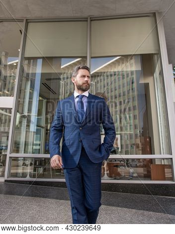 Business Success. Successful Man In Businesslike Suit. Entrepreneur Outside The Office