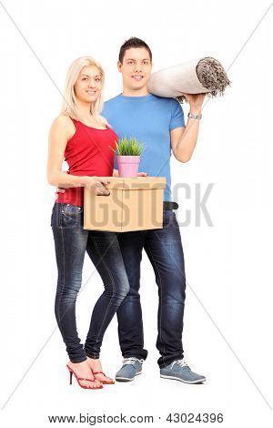 Full length portrait of a young male and female holding a moving box and carpet isolated on white background