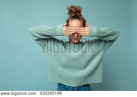 Photo Of Young Beautiful Blonde Woman With Sincere Emotions Wearing Casual Blue Pullover Isolated Ov