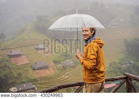Man Tourist With Umbrella In Sapa In The Fog, Northwest Vietnam. Vietnam Travel Concept. Unesco Heri