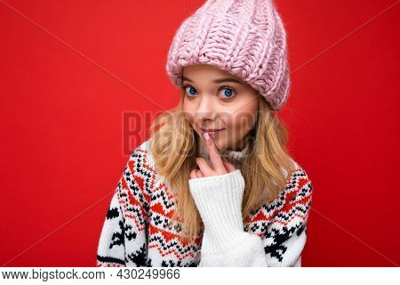 Photo Of Young Beautiful Blond Lady With Sincere Emotions Wearing Pink Knitted Hat And Winter Pullov