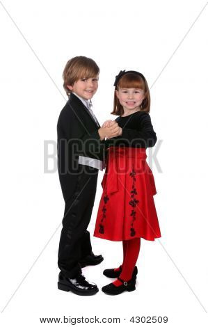 Boy And Girl In Formal Clothing Dancing Together