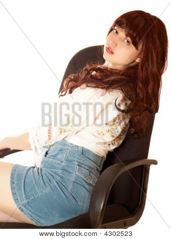 Young Beautiful Woman In Armchair