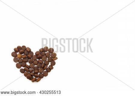 Dry Pet Food For Dogs And Cats In The Shape Of A Heart Isolated On White Background, Copy Space, Top