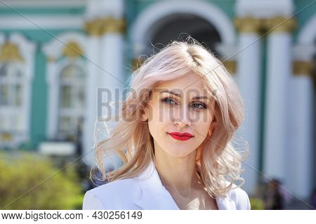 Beautiful Young Woman, With Blond Curly Hair And Smiling In The Street. Outdoor Portrait Of Laughing