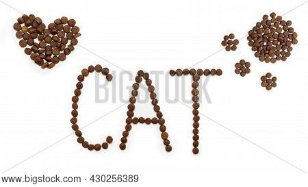 Dry Dog Food In The Shape Of A Heart, A Cats Paw And Letters Cat, Isolated On A White Background. He