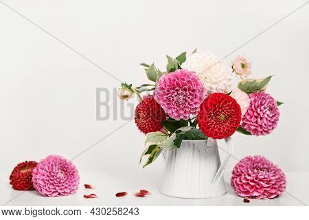 Autumn Dahlias Flowers Bouquet On White Table. Wall Table Background, Copy Space