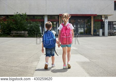 Back To School. Boy And Girl Go To School With Backpacks. The Beginning Of The School Year, Children