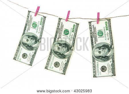 Paper money on rope isolated on white