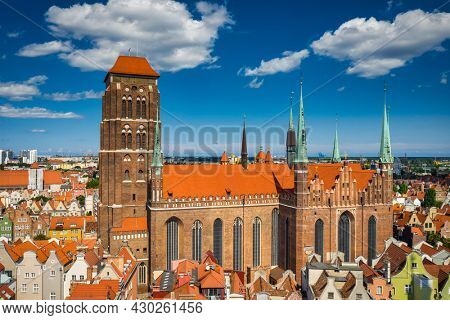 Beautiful architecture of the main city of Gdansk with the St. Marys basilica at summer. Poland
